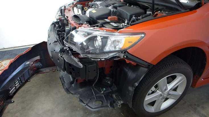Процесс замены переднего бампера Тойота Камри